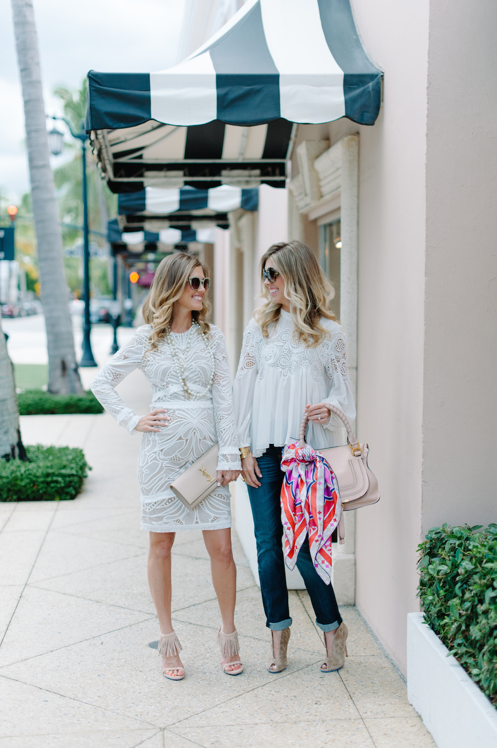 white_dress_blouse_jeans_fringe_heels_clutch_handbag_booties_sunglasses