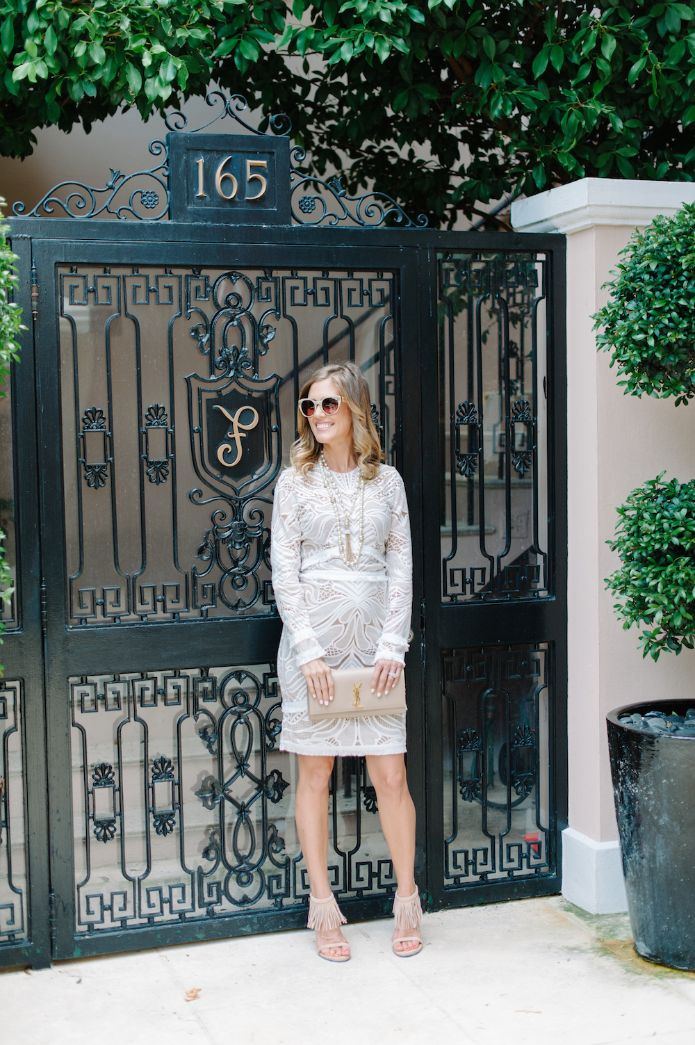 white_dress_fringe_heels_clutch_sunglasses_pearls