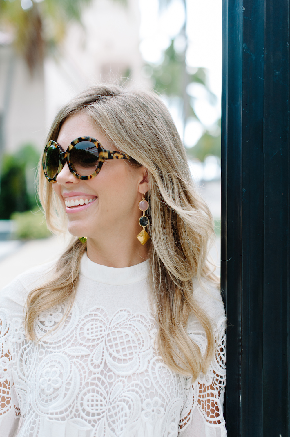 white_lace_blouse_sunglasses_earrings