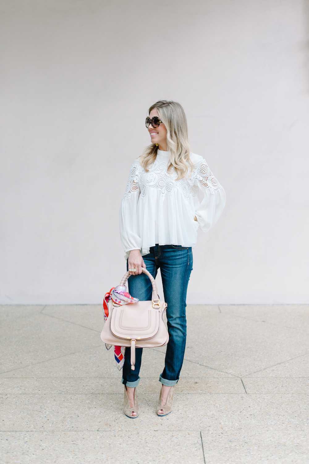 white_lace_blouse_jeans_handbag_booties_sunglasses_scarf
