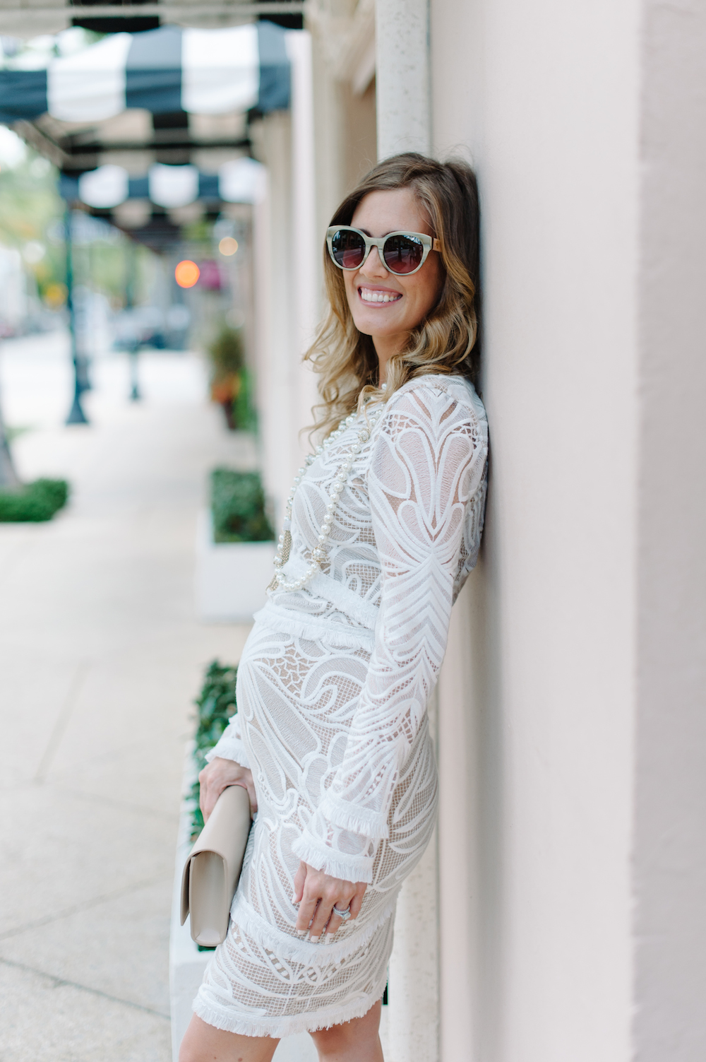 white_dress_clutch_sunglasses_pearls