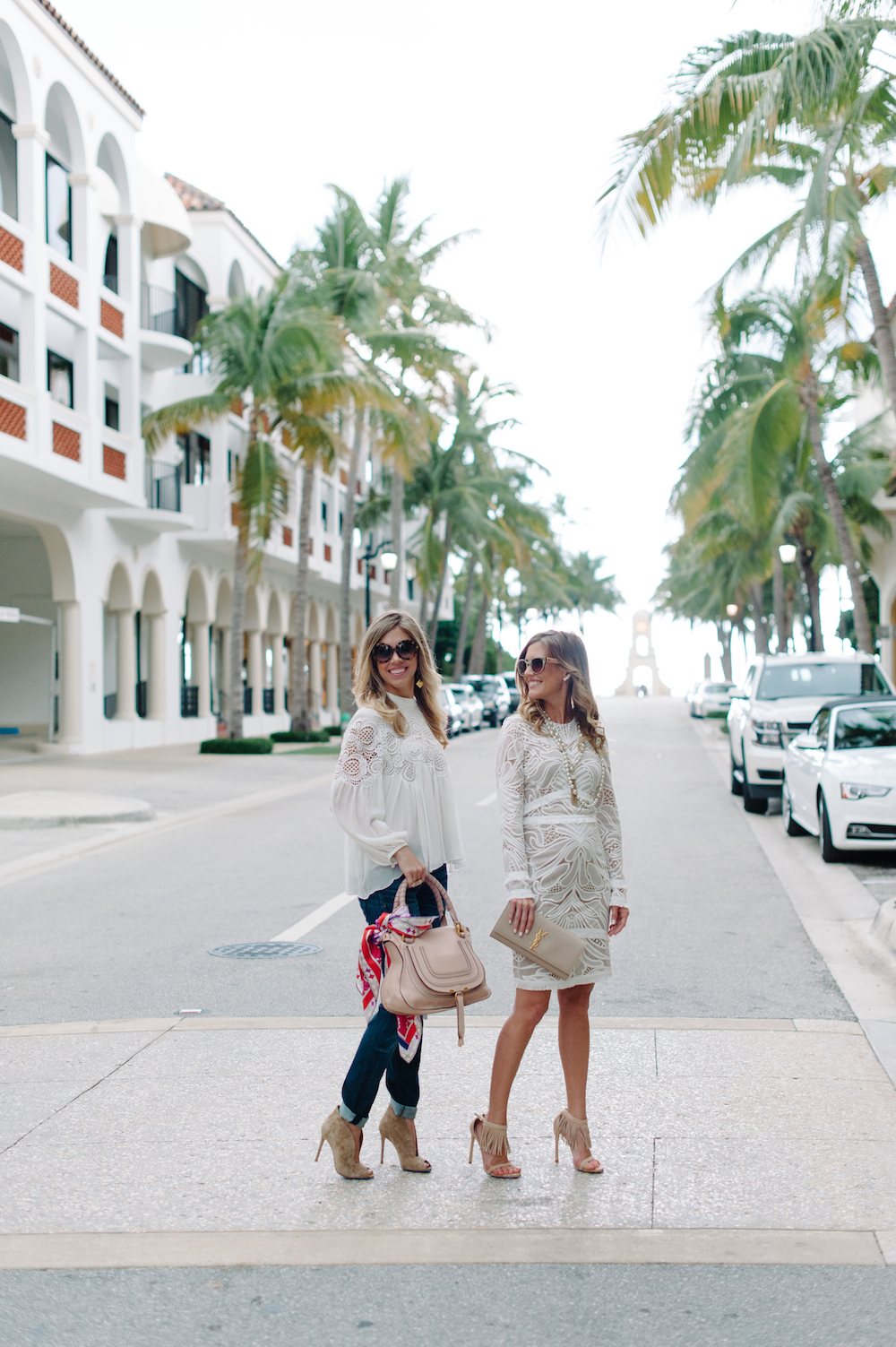 white_dress_blouse_jeans_fringe_heels_clutch_handbag_booties_sunglasses_scarf