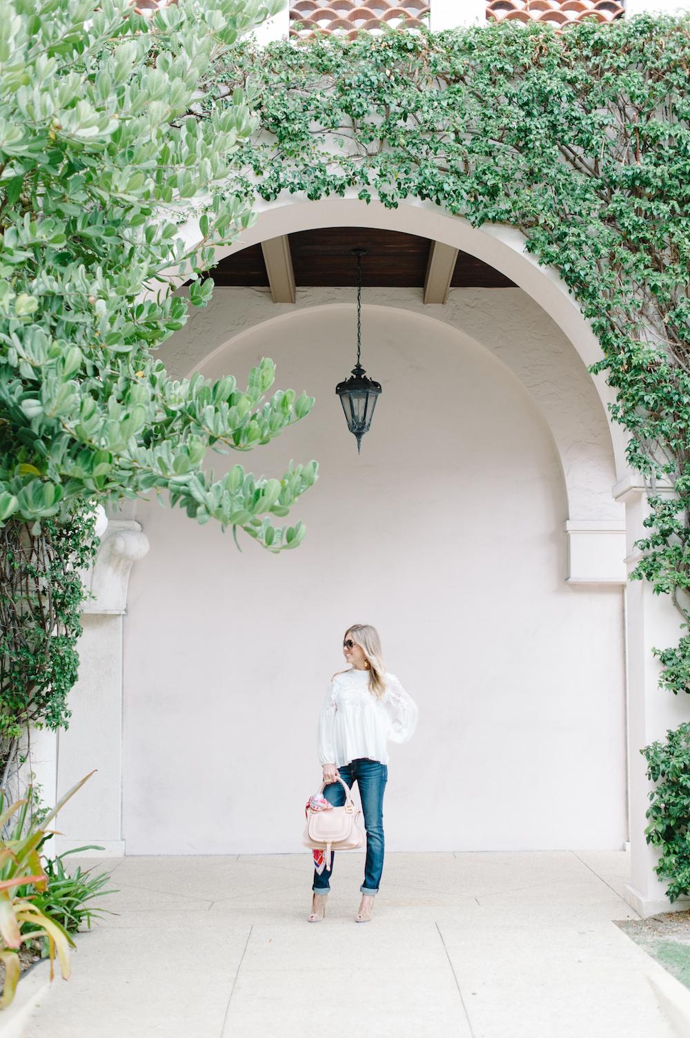 white_lace_blouse_jeans_handbag_booties_sunglasses_scarf