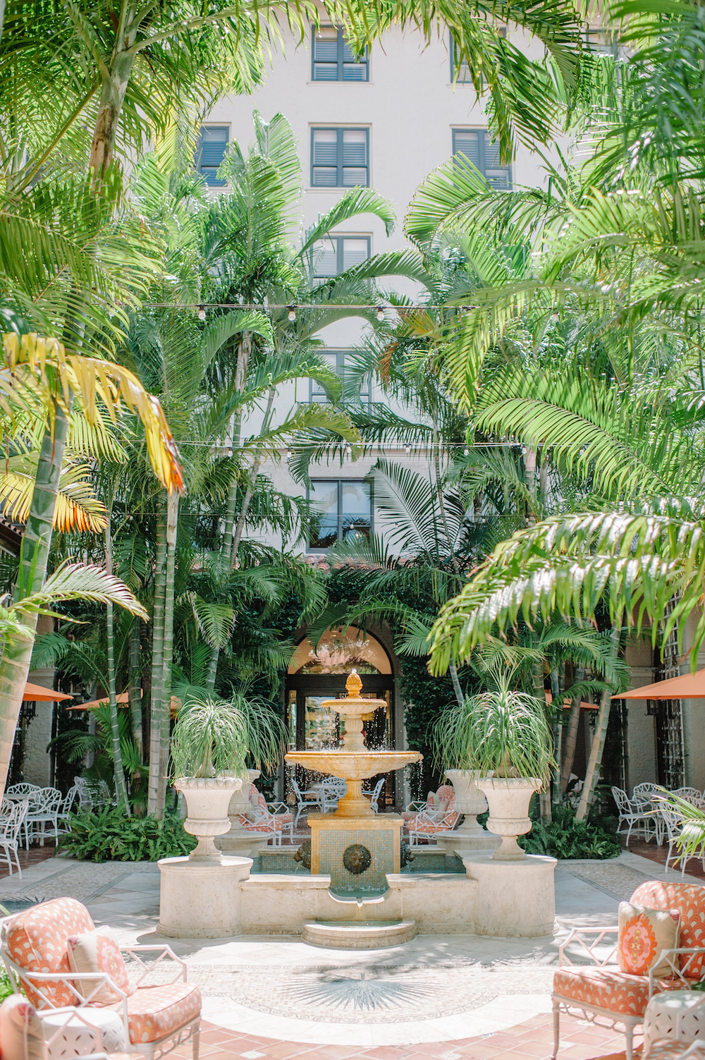 vacation_the_breakers_palm_beach_courtyard_trina_turk_chairs