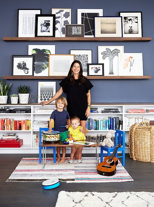 one kings lane_rebecca minkoff_FAMILY PORTRAIT IN FRONT OF GALLERY WALL