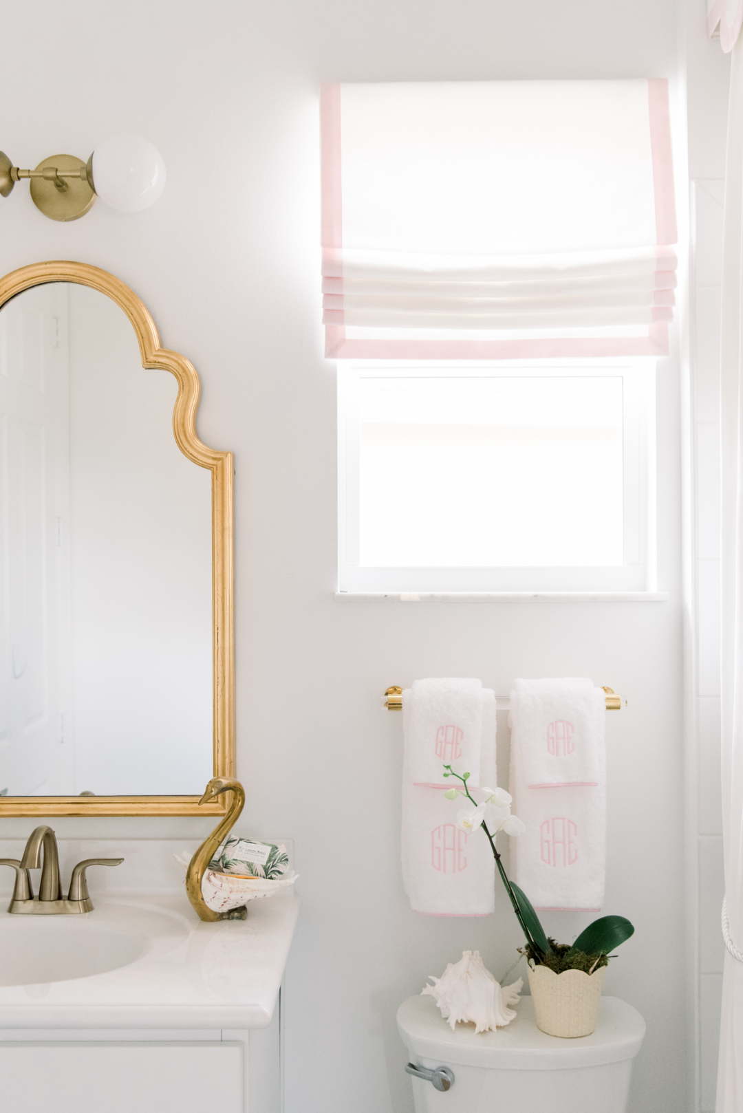 pink white and gold bathroom